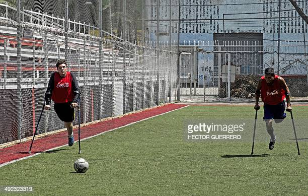 Players of 'Lobos de Jalisco' a team of amputees take part in a training session in Guadalajara Mexico on May 19 2014 The are 11 teams of people with...