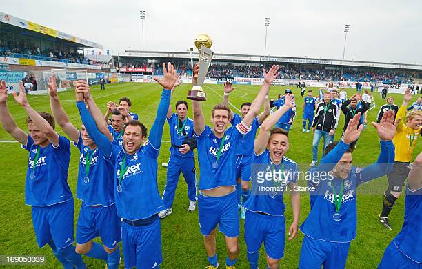 Players of Lotte celebrate the championship after the Regionalliga West match between Sportfreunde Lotte and RW Essen at ConnectM Arena on May 19...