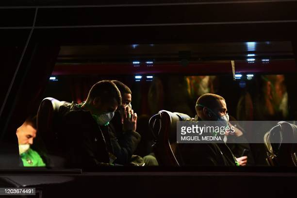Players of Ludogorets wear protective face masks as a safety measure against the COVID19 the novel coronavirus as they sit in a bus on their way to...