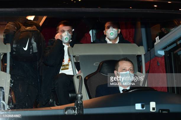 TOPSHOT Players of Ludogorets wear protective face masks as a safety measure against the COVID19 the novel coronavirus as they sit in a bus on their...