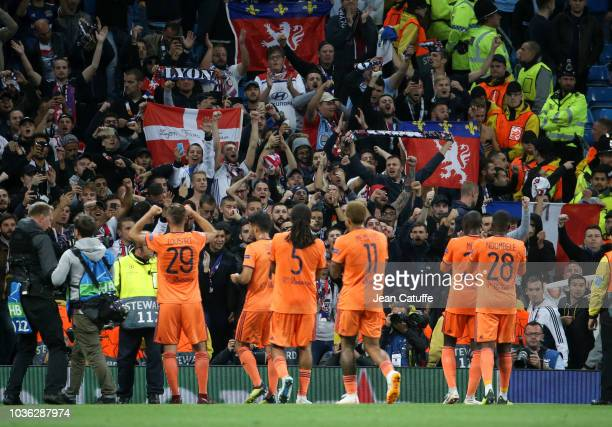 Players of Lyon celebrate their victory with their fans following the Group F match of the UEFA Champions League between Manchester City and...
