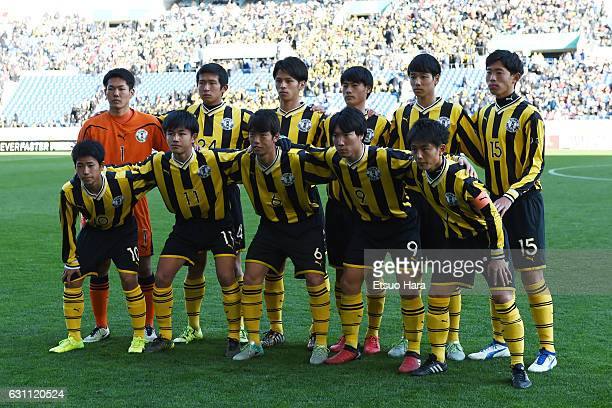 Players of Maebashi Ikuei line up for team photos prior to the 95th All Japan High School Soccer Tournament semi final match between Maebashi Ikuei...