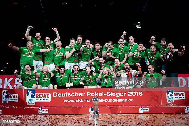 Players of Magdeburg celebrate after winning the DKB REWE Final Four Finale 2016 between SG Flensburg Handewitt and SC Magdeburg at Barclaycard Arena...