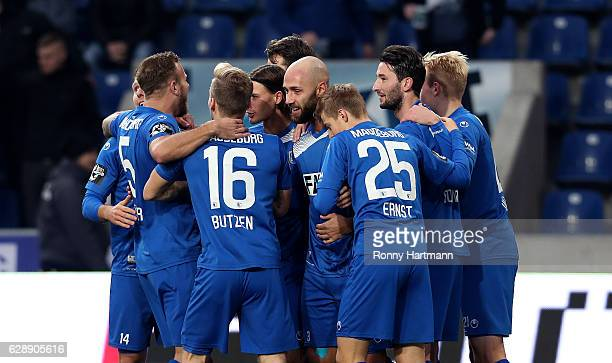 Players of Magdeburg celebrate their team's opening goal during the Third League match between 1 FC Magdeburg and VfR Aalen at MDCCArena on December...