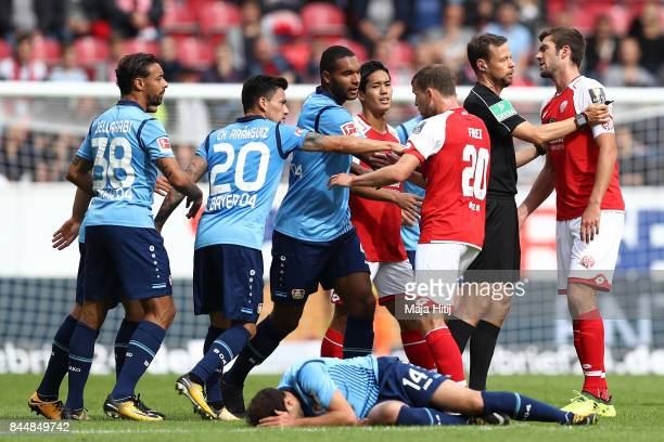 Players of Mainz and Leverkusen gather after a foul against Admir Mehmedi of Bayer Leverkusen during the Bundesliga match between 1 FSV Mainz 05 and...