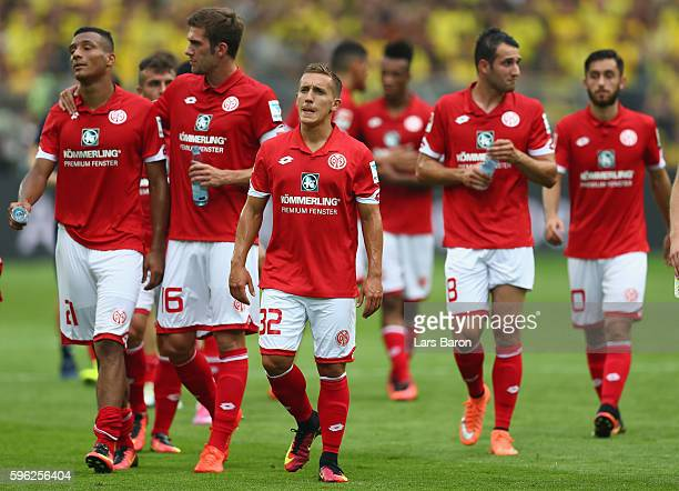 Players of Mainz are looking dejected after loosing the Bundesliga match between Borussia Dortmund and 1 FSV Mainz 05 at Signal Iduna Park on August...