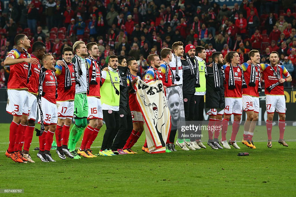 Players of Mainz celebrate after the Bundesliga match between 1. FSV Mainz 05 and Borussia Moenchengladbach at Coface Arena on January 29, 2016 in Mainz, Germany.