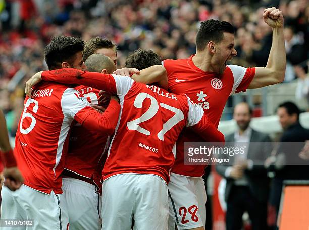 Players of Mainz celebrates after Nicolai Mueller is scoring his teams first goal during the Bundesliga match between FSV Mainz 05 and 1.FC Nuernberg...