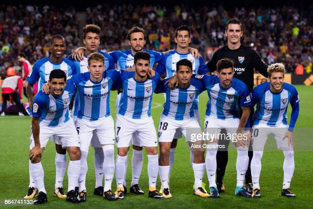 Players of Malaga CF pose for a team photo before the La Liga match between Barcelona and Malaga at Camp Nou on October 21 2017 in Barcelona Spain
