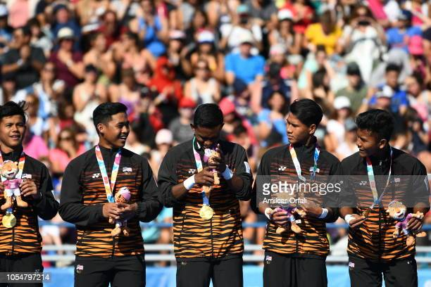 Players of Malasya celebrate on the podium after winning the Gold Medal during day 8 of the Buenos Aires Youth Olympics Games at Youth Olympic Park...