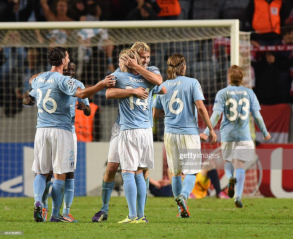 Players of Malmo celebrate the victory after UEFA Champions League qualifying play-offs round second leg match between Malmo FF and Red Bull Salzburg on August 27, 2014 in Malmo, Sweden.