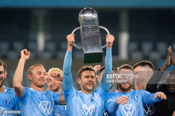 Players of Malmo FF celebrates the first place in Allsvenskan match between Malmo FF and Ostersunds FK at Eleda Stadion on December 6, 2020 in Malmo,...