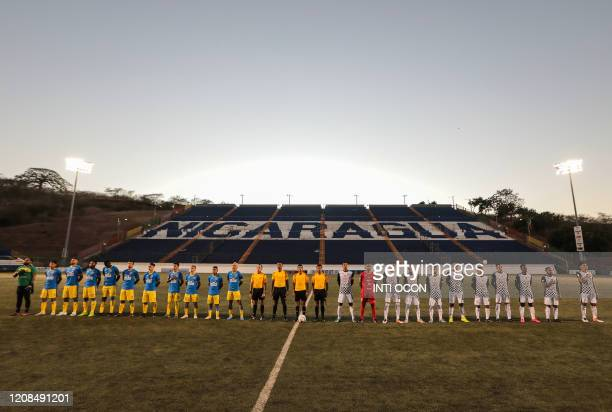 Players of Managua FC and Cacique Diriangen FC sign the national anthem before their football match at the National stadium in Managua on March 28...