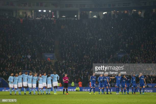 Players of Manchester City and Leicester City line up for the penalties during the Carabao Cup QuarterFinal match between here Leicester City v...