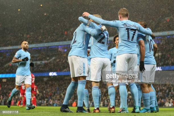 Players of Manchester City celebrate during the Premier League match between Manchester City and Watford at Etihad Stadium on January 2 2018 in...
