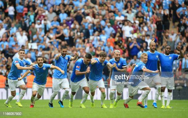 Players of Manchester City celebrate following their team's victory in the penalty shoot out during the FA Community Shield match between Liverpool...