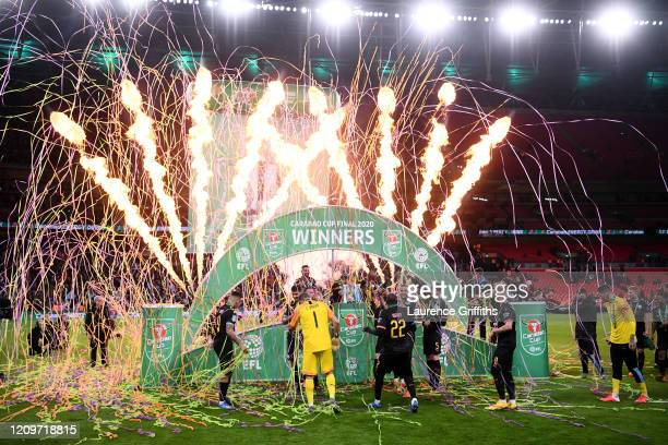 Players of Manchester City celebrate following victory during the Carabao Cup Final between Aston Villa and Manchester City at Wembley Stadium on...