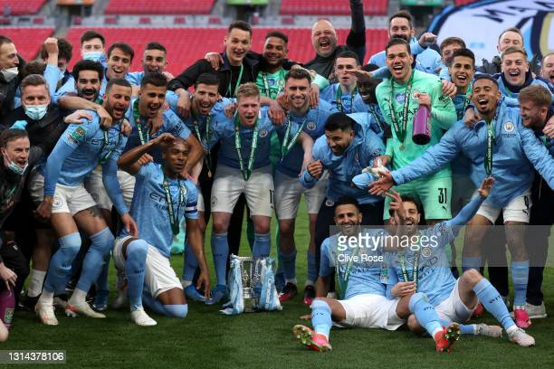 Players of Manchester City celebrate with the trophy after winning the Carabao Cup after the Carabao Cup Final between Manchester City and Tottenham...