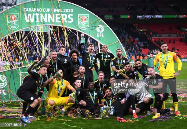 Players of Manchester City celebrate with the trophy following victory during the Carabao Cup Final between Aston Villa and Manchester City at...