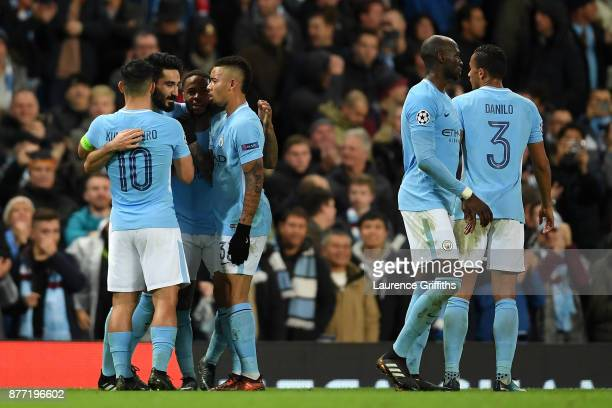 Players of Manchester City hug each other after the UEFA Champions League group F match between Manchester City and Feyenoord at Etihad Stadium on...