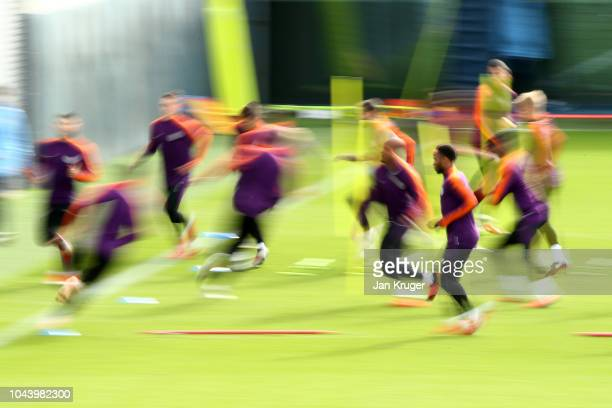 Players of Manchester City in action during a training session ahead of their Group F match against TSG Hoffenheim in the UEFA Champions League at...