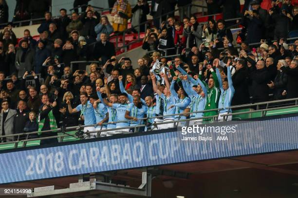 Players of Manchester City lift the Carabao Cup trophy during the Carabao Cup Final match between Arsenal and Manchester City at Wembley Stadium on...