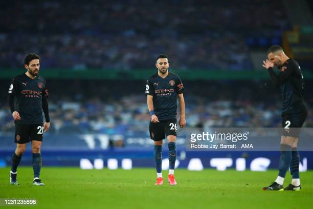 Players of Manchester City react during the Premier League match between Everton and Manchester City at Goodison Park on February 17, 2021 in...