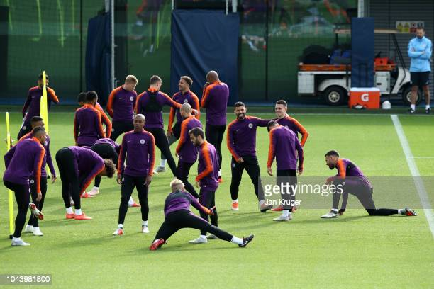 Players of Manchester City warm up during a training session ahead of their Group F match against TSG Hoffenheim in the UEFA Champions League at...
