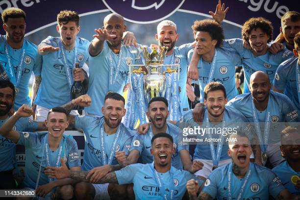 Players of Manchester City with the English Premier League Trophy as they celebrate becoming champions after the Premier League match between...