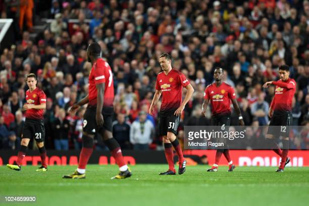 Players of Manchester United looks dejected during the Premier League match between Manchester United and Tottenham Hotspur at Old Trafford on August...
