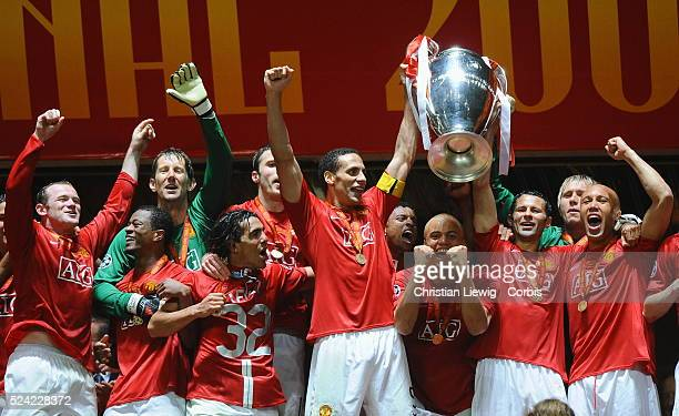 Players of Manchester with the trophy lifted by Rio Ferdinand and Ryan Giggs after the UEFA Champions League Final between Chelsea and Manchester...
