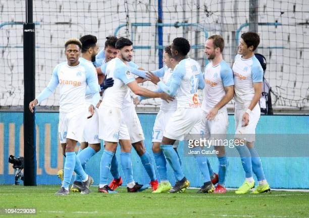 Players of Marseille celebrate the winning goal of Boubacar Kamara during the French Ligue 1 match between Olympique de Marseille and Girondins de...