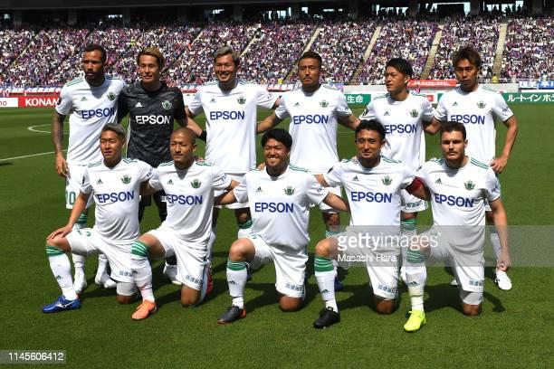 Players of Matsumoto Yamaga pose for photographs prior to the J.League J1 match between FC Tokyo and Matsumoto Yamaga at Ajinomoto Stadium on April...