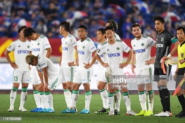 Players of Matsumoto Yamaga show dejection after the J.League J1 match between Yokohama F.Marinos and Matsumoto Yamaga at Nissan Stadium on June 22,...