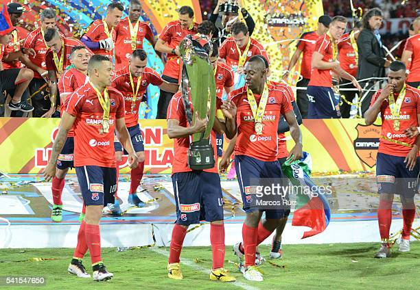 Players of Medellin celebrate with the trophy after winning a second leg final match between Independiente Medellin and Junior as part of Liga Aguila...