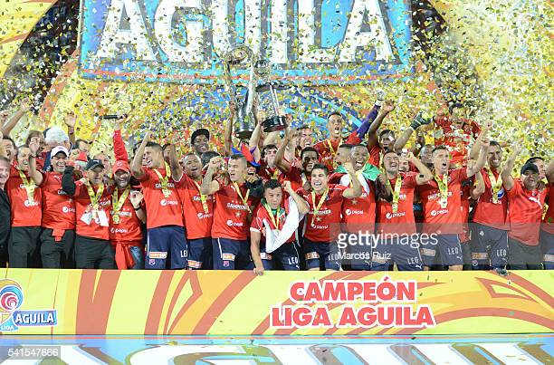 Players of Medellin lift the trophy after winning a second leg final match between Independiente Medellin and Junior as part of Liga Aguila I 2016 at...