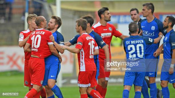 Players of Meppen and Aalen argue during the 3 Liga match between SV Meppen and VfR Aalen at Haensch Arena on September 10 2017 in Meppen Germany