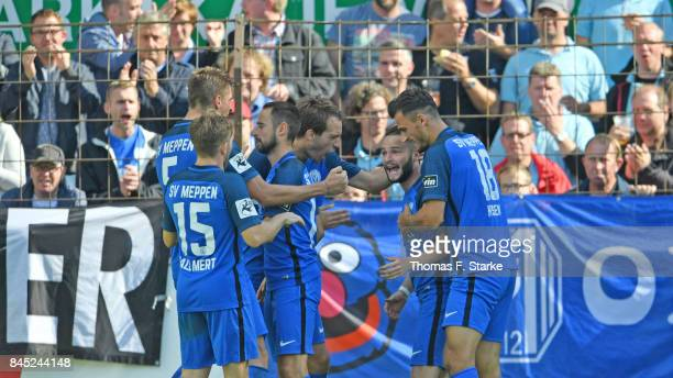 Players of Meppen celebrate with Marius Kleinsorge who scored his teams first goal during the 3 Liga match between SV Meppen and VfR Aalen at Haensch...