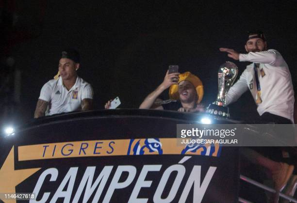 Players of Mexican football team Tigres celebrate the obtention of the Mexican Clausura title as they ride on a bus across the streets of Monterrey...