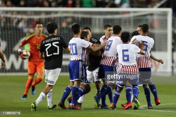Players of Mexico and Paraguay fight during the friendly match between Paraguay and Mexico at Levi's Stadium on March 26 2019 in Santa Clara...