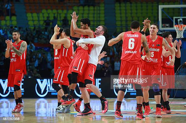 Players of Mexico celebrate after winning a second stage match between Venezuela and Mexico as part of the 2015 FIBA Americas Championship for Men at...