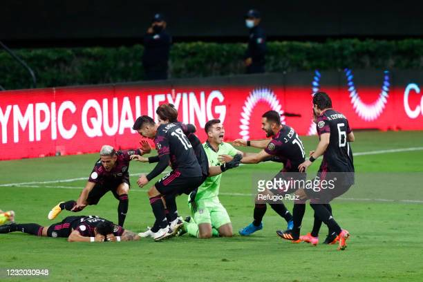 Players of Mexico celebrate after winning the final match between Honduras and Mexico as part of the 2020 Concacaf Men's Olympic Qualifying at Akron...
