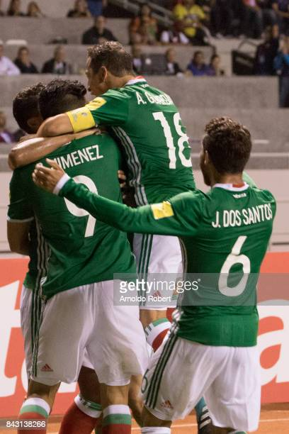 Players of Mexico celebrate their team's first goal during the match between Costa Rica and Mexico as part of the FIFA 2018 World Cup Qualifiers at...