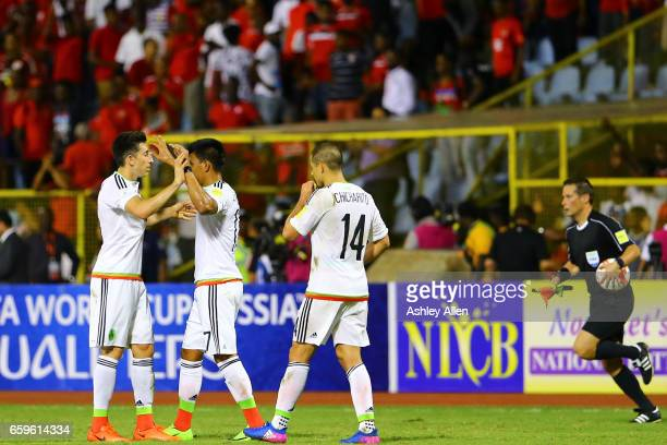Players of Mexico celebrate victory after the fifth round match between Trinidad & Tobago and Mexico as part of the FIFA 2018 World Cup Qualifiers at...