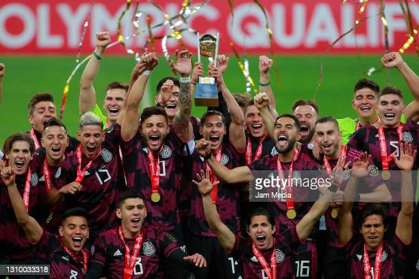 Players of Mexico celebrate with the champion trophy during the final match between Honduras and Mexico as part of the 2020 Concacaf Men's Olympic...