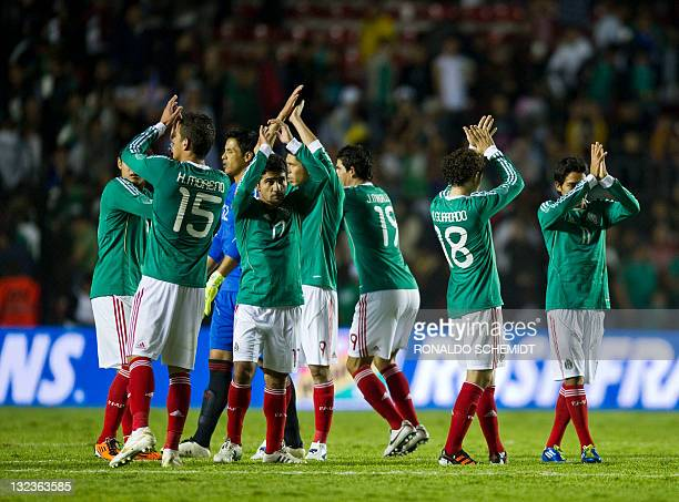 Players of Mexico celebrates during a friendly soccer match against Serbia in Queretaro Mexico on November 11 2011 Mexico won 20 AFP PHOTO/RONALDO...