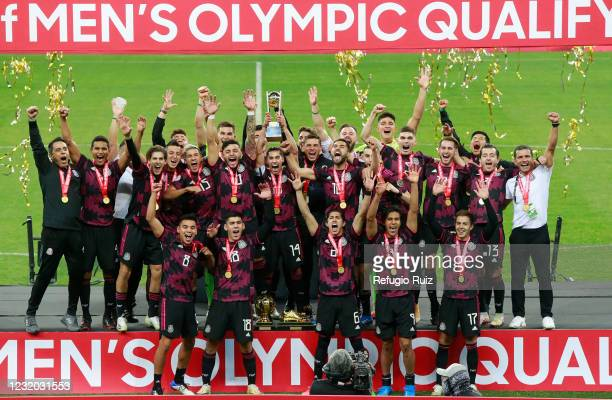 Players of Mexico lift the trophy after winning the 2020 Concacaf Men's Olympic Qualifying after the final match between Honduras and Mexico as part...