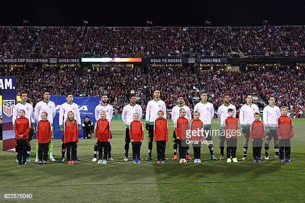 Players of Mexico line up during their National Anthem prior the match between USA and Mexico as part of FIFA 2018 World Cup Qualifiers at MAPFRE...