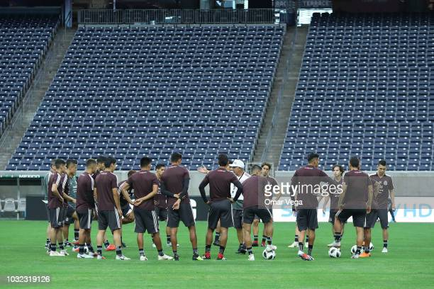 Players of Mexico make a circle to talk with coach Ricardo Ferretti during a training session ahead Mexico's international friendly match against...