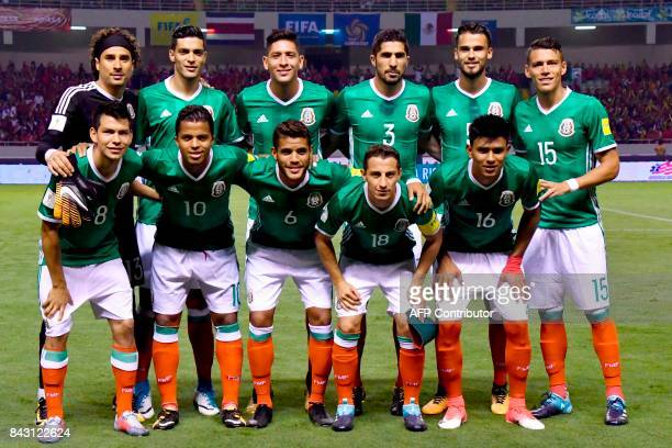 Players of Mexico pose for pictures before the start of their 2018 World Cup football qualifier match against Costa Rica in San Jose on September 5...